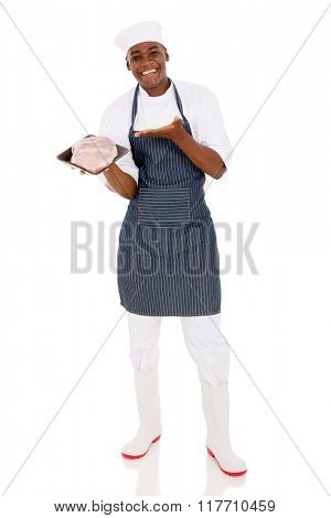 happy young african butcher presenting quality meat on white background