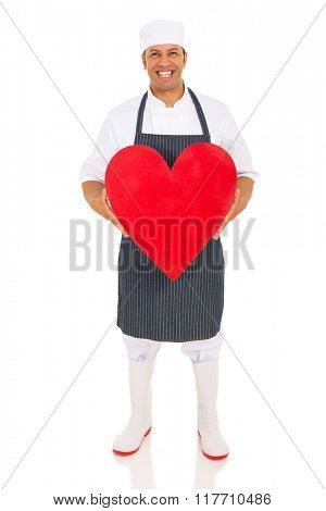 portrait of mid age butcher holding heart isolated on white
