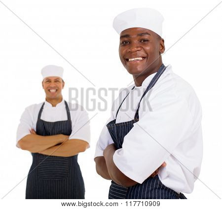 good looking african butcher standing in front of colleague