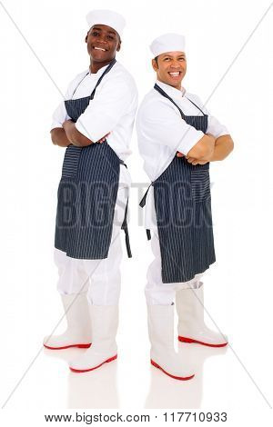 confident butchers standing back to back isolated on white background
