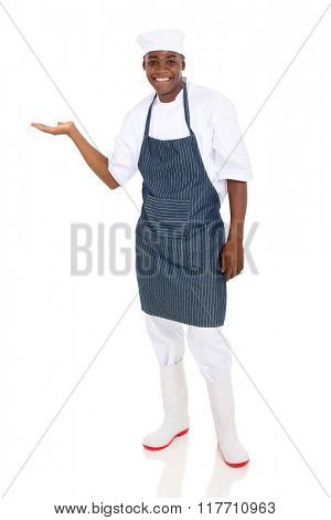 happy male african american chef presenting empty space