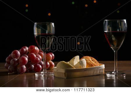 Pumpkin and grapes in the dark background, studio picture