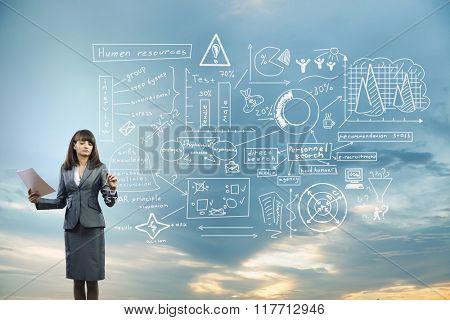 Businesswoman sketching her ideas