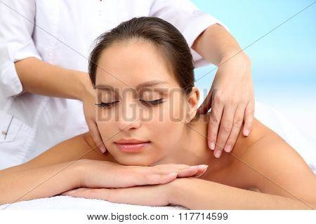 Beautiful woman getting massage in spa salon