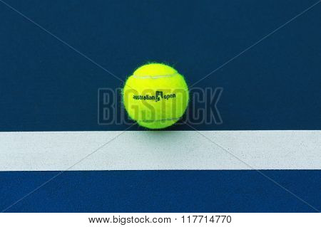Wilson tennis ball with Australian Open logo on tennis court