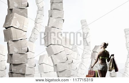 Girl on pile of boxes