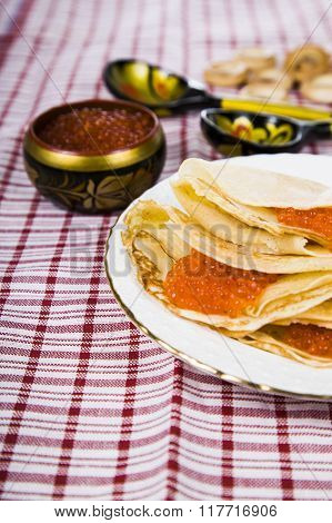 Pancakes With Red Caviar On A Table.