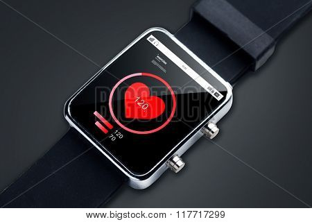 modern technology, object, healthcare and media concept - close up of black smart watch with pulsometer and heart-rate icon on screen