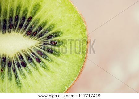 fruits, diet, food and objects concept - close up of ripe kiwi slice on table