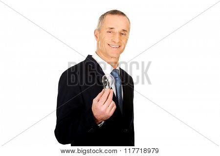 Portrait of businessman with light bulb