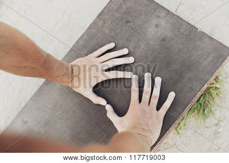 fitness, sport, training and lifestyle concept - close up of male hands exercising on bench outdoors