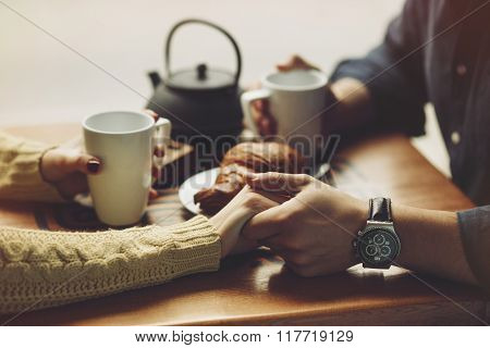 Couple in love drinking coffee. Hands close up