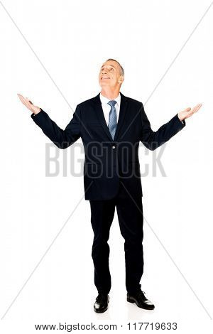 Full length businessman with hands open gesture