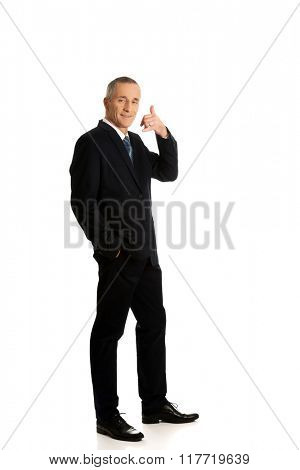 Full length businessman with call me gesture