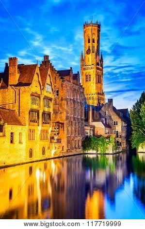 Bruges Belgium. Image with Rozenhoedkaai in Brugge Dijver river canal twilight and Belfort (Belfry) tower.