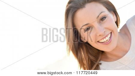 Portrait of cheerful natural woman with long hair