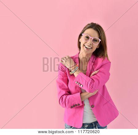 Cheerful girl wearing eyeglasses, pink color