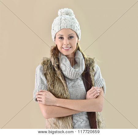 Closeup of woman wearing winter clothes, isolated