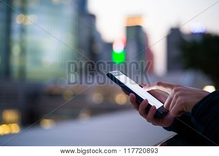 Woman using her Mobile Phone in the street