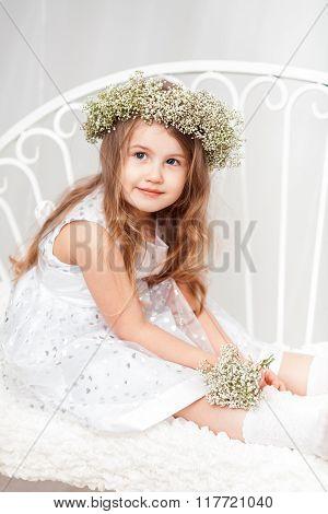 Cute Little Girl With A Wreath