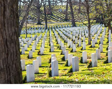 WASHINGTON DC USA - DECEMBER 26 2014: Gravestones on Arlington National Cemetery decorated for Christmas time.