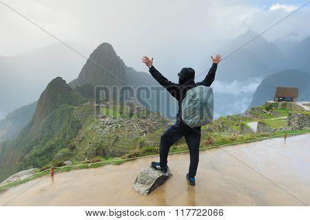 Tourist looking over Machu Picchu, Peru