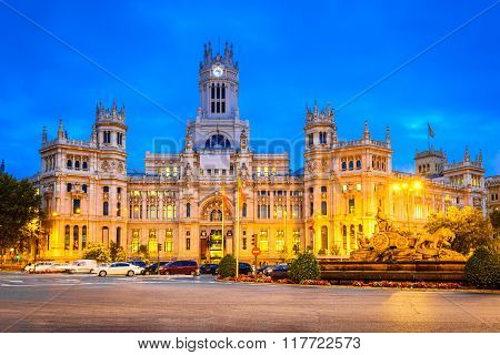 Madrid Spain. Dusk view of Plaza de la Cibeles ( Cybele's Square ) - Central Post Office ( Palacio de Comunicaciones )