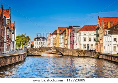 Bruges Belgium. Scenery with Spiegelrei water canal in Brugge cityscape of Flanders. Belgian medieval town.