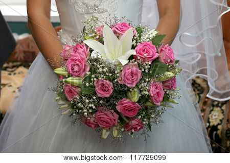 Beautiful Wedding Bouquet Of Roses In The Brides Hands