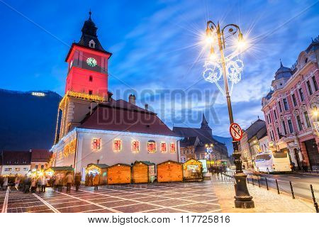 BRASOV, ROMANIA - 26 DECEMBER 2015: Brasov Romania. Christmas Market in Main Square with Xmas Tree and lights. Transylvania landmark.