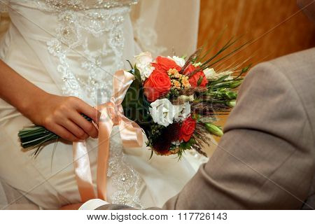 Beautiful Wedding Bouquet Of Roses In The Bride's Hand