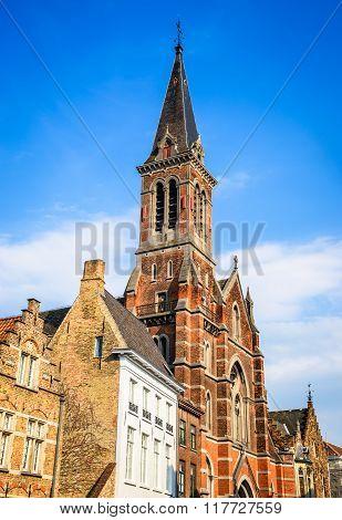 Bruges Belgium. Image of Sacred Heart church in Brugge Flanders. Flemish Jesuit religious architecture.