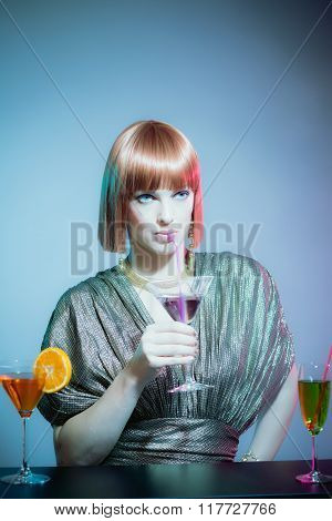 Glamorous Woman Sipping Cocktail At Disco Bar