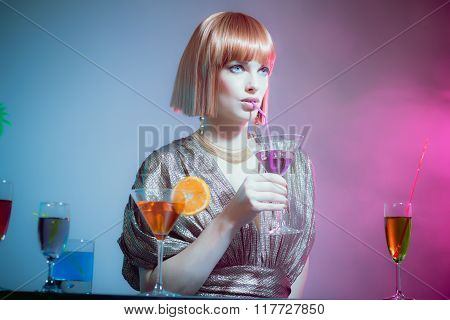 Glamorous Woman At Bar Sipping Cocktail In Disco