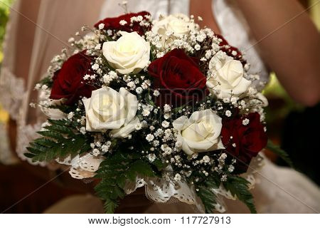 Beautiful Wedding Bouquet Of White And Red  Roses In The Bride's