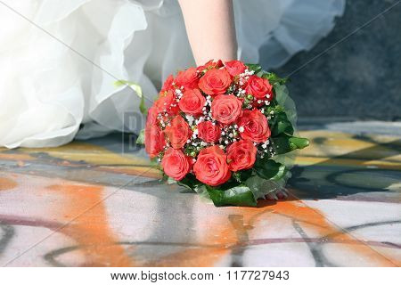 Beautiful Wedding Bouquet Of Red Roses In The Brides Hand