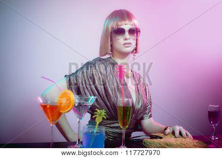 Glamorous Woman Wearing Sunglasses In Smoky Bar