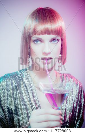 Red Haired Woman Sipping Martini Through Straw