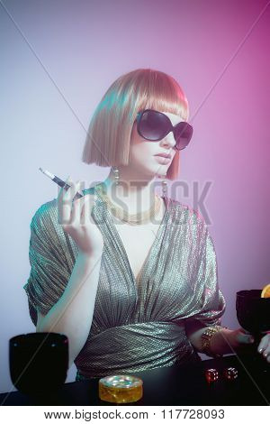 Glamorous Woman Standing At Bar Smoking Cigarette