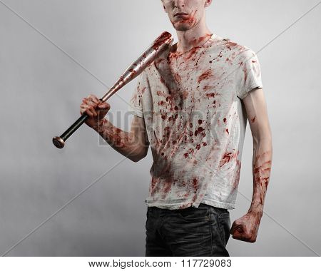 Bloody Topic: The Guy In A Bloody T-shirt Holding A Bloody Bat On A White Background