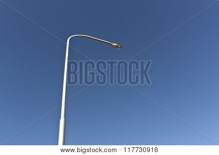 Lamp Post And Blue Sky.