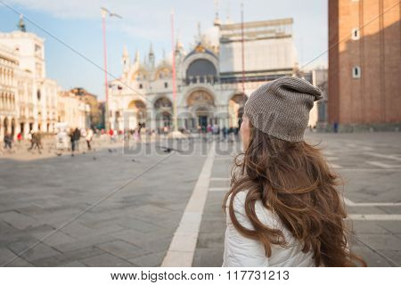 Seen From Behind Young Woman Standing On Piazza San Marco