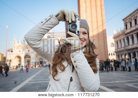 Woman Taking Photos With Retro Photo Camera On Piazza San Marco