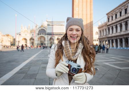 Smiling Woman With Retro Photo Camera On Piazza San Marco