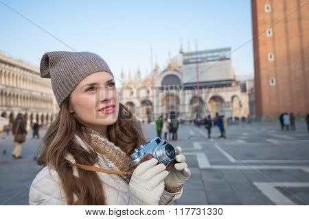 Young Woman Tourist With Retro Photo Camera On Piazza San Marco