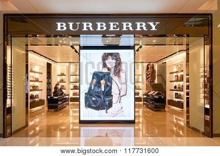 HONG KONG - JANUARY 26, 2016: entryway of Burberry store. Burberry Group plc is a British luxury fashion house, distributing outerwear, fashion accessories, fragrances, sunglasses, and cosmetics.
