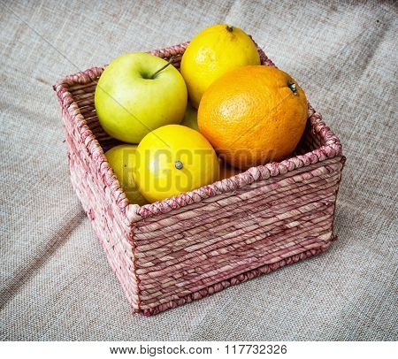 Wicker Basket With Apples, Oranges And Lemons, Healthy Food Theme