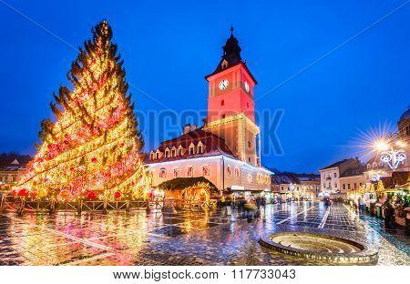 BRASOV ROMANIA - 16 DECEMBER 2015: Night image of Christmas Market in Brasov December 2015. Main Square and Council House landmark of Transylvania Romania.