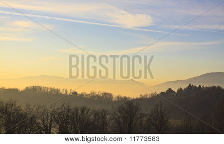 Panorama With Fog And Mountains In Background