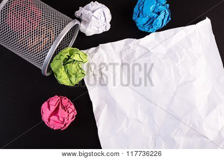 Creased Color Papers And Office Bin With Crumpled White Paper